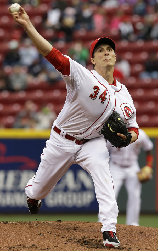 Photo - Cincinnati Reds starting pitcher Homer Bailey throws against the Milwaukee Brewers in the first inning of a baseball game on Thursday, May 1, 2014, in Cincinnati. (AP Photo/Al Behrman)