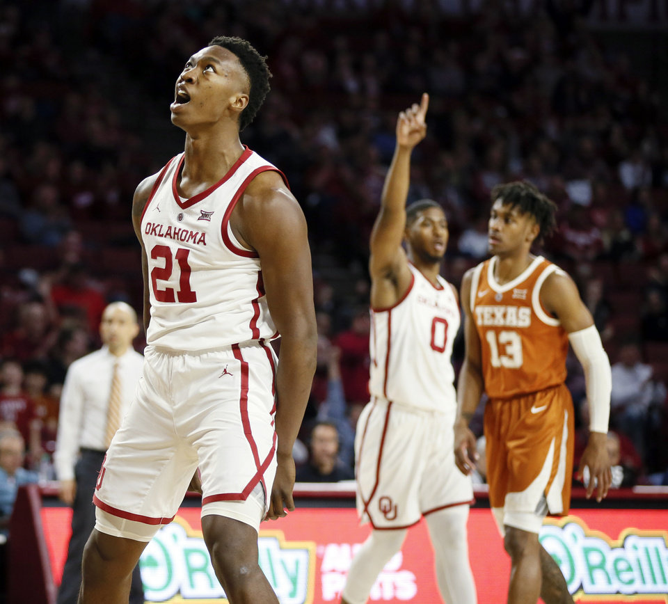 Photo - Oklahoma's Kristian Doolittle (21) reacts after making a shot and being fouled in the first half during a men's college basketball game between the Oklahoma Sooners and the Texas Longhorns at the Lloyd Noble Center in Norman, Okla., Saturday, Feb. 23, 2019. Photo by Nate Billings, The Oklahoman