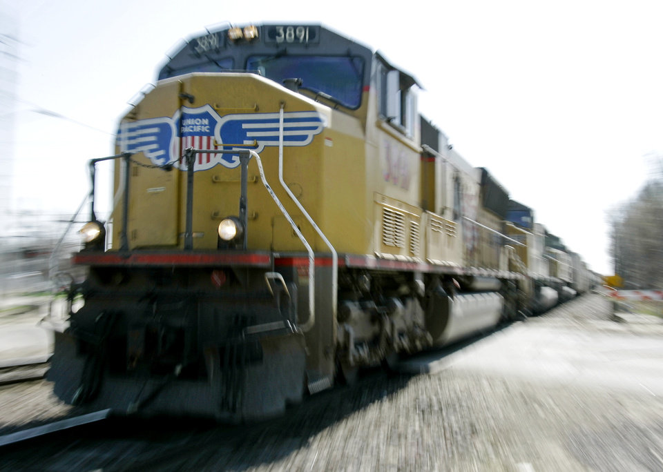 FILE - In this Tuesday, April 22, 2008, file photo, a Union Pacific train travels through Council Bluffs, Iowa.  Union Pacific's fourth-quarter profit chugged ahead 7 percent in 2012 because the railroad raised shipping rates and collected more fuel surcharges. (AP Photo/Nati Harnik, File)