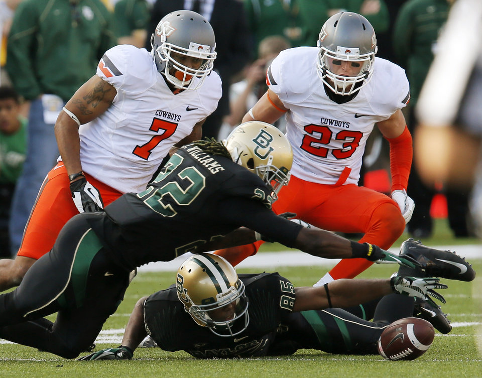 Photo - Oklahoma State's Shamiel Gary (7) and Zack Craig (23) along with Baylor's Joe Williams (22) and Jay Lee (85) try to recover an OSU onside kick in the fourth quarter during a college football game between the Oklahoma State University Cowboys (OSU) and the Baylor University Bears at Floyd Casey Stadium in Waco, Texas, Saturday, Dec. 1, 2012. Baylor recovered the onside kick and won the game. Photo by Nate Billings, The Oklahoman