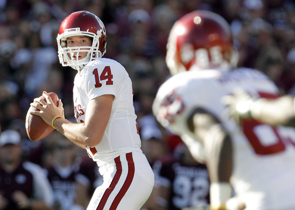 OU quarterback Sam Bradford, left, will be back in the spotlight on Saturday against BYU.  Photo by BY NATE BILLINGS, THE OKLAHOMAN