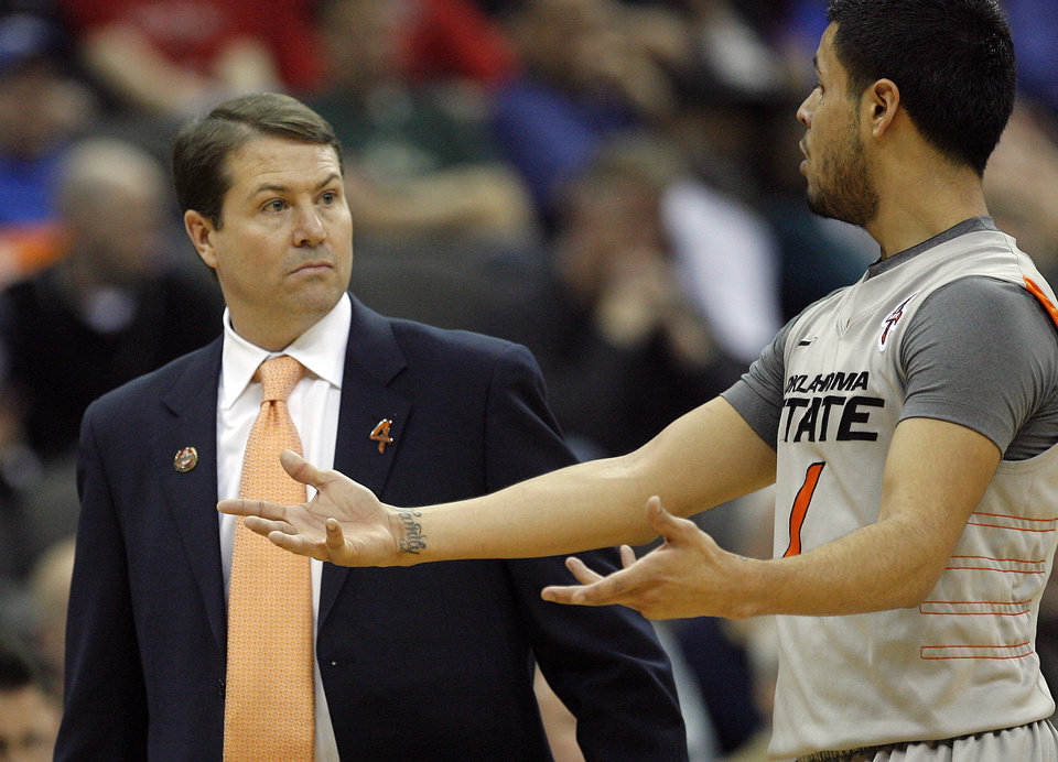 Oklahoma State head coach Travis Ford talks with Oklahoma State's Cezar Guerrero (1) during the Big 12 tournament men's basketball game between the Oklahoma State Cowboys and the Texas Tech Red Raiders at the Sprint Center, Wednesday, March, 7, 2012. Photo by Sarah Phipps, The Oklahoman
