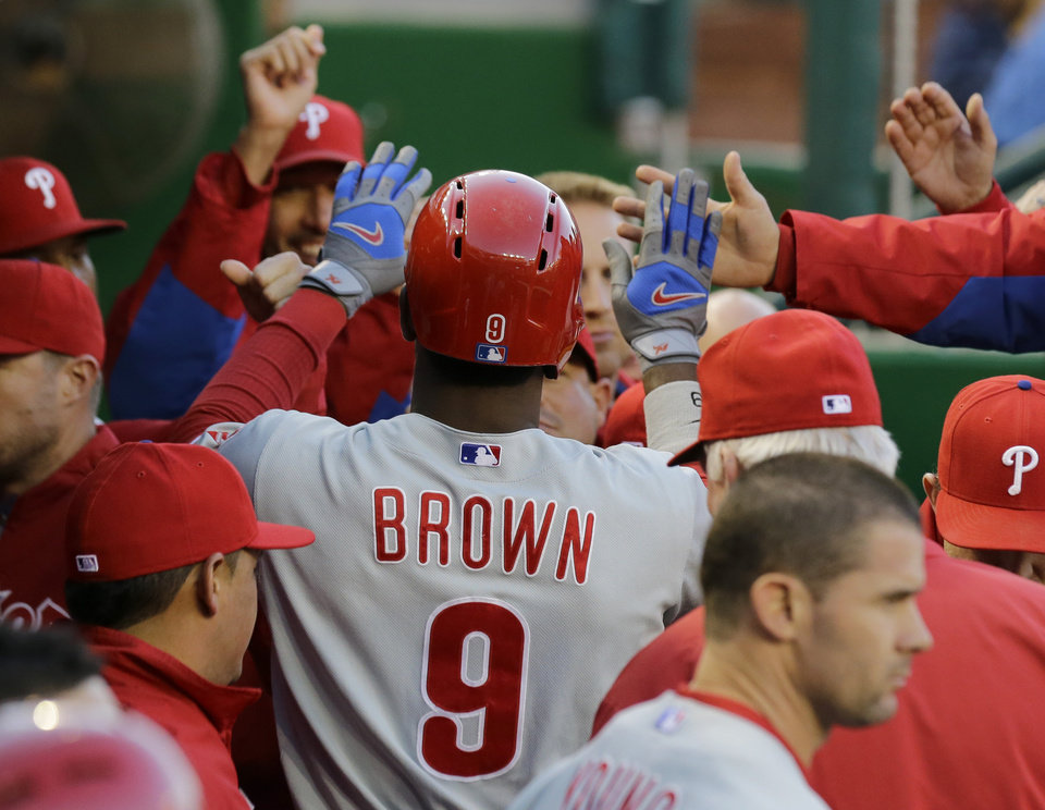 Photo - Philadelphia Phillies' Domonic Brown (9) celebrates after his solo home run during the second inning of a baseball game against the Washington Nationals at Nationals Park, Saturday, May 25, 2013, in Washington. (AP Photo/Alex Brandon)