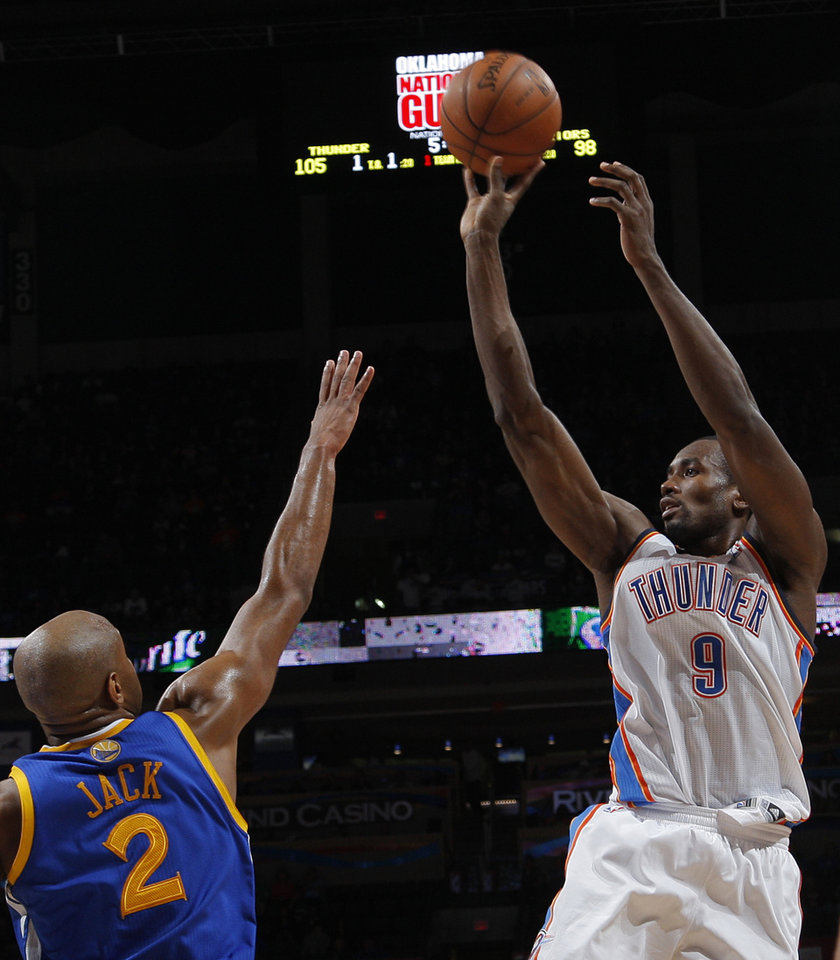 Oklahoma City 's Serge Ibaka (9) takes a shot over Golden State's Jarrett Jack (2) during an NBA basketball game between the Oklahoma City Thunder and the Golden State Warriors at Chesapeake Energy Arena in Oklahoma City, Sunday, Nov. 18, 2012.  Photo by Garett Fisbeck, The Oklahoman