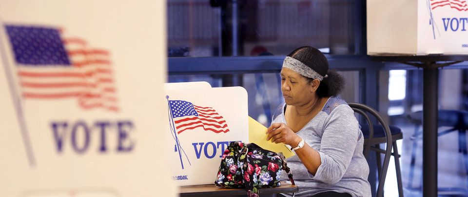Photo - Precinct 114 voters mark their ballots inside Millwood Field House on Tuesday, Sep 12, 2017. Photo by Jim Beckel, The Oklahoman