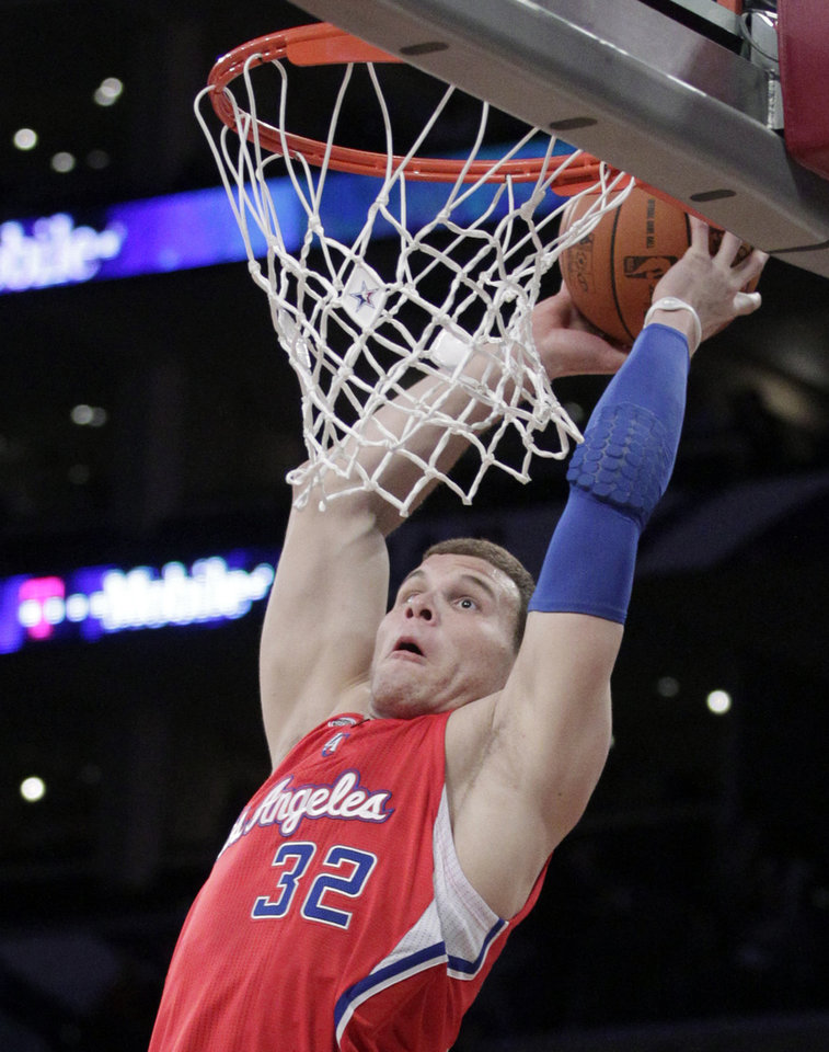 Photo - Rookie Blake Griffin, of the Los Angeles Clippers, goes up for a dunk during the first half of the Rookie Challenge game during the NBA basketball All-Star Weekend, Friday, Feb. 18, 2011, in Los Angeles. (AP Photo/Jae C. Hong)