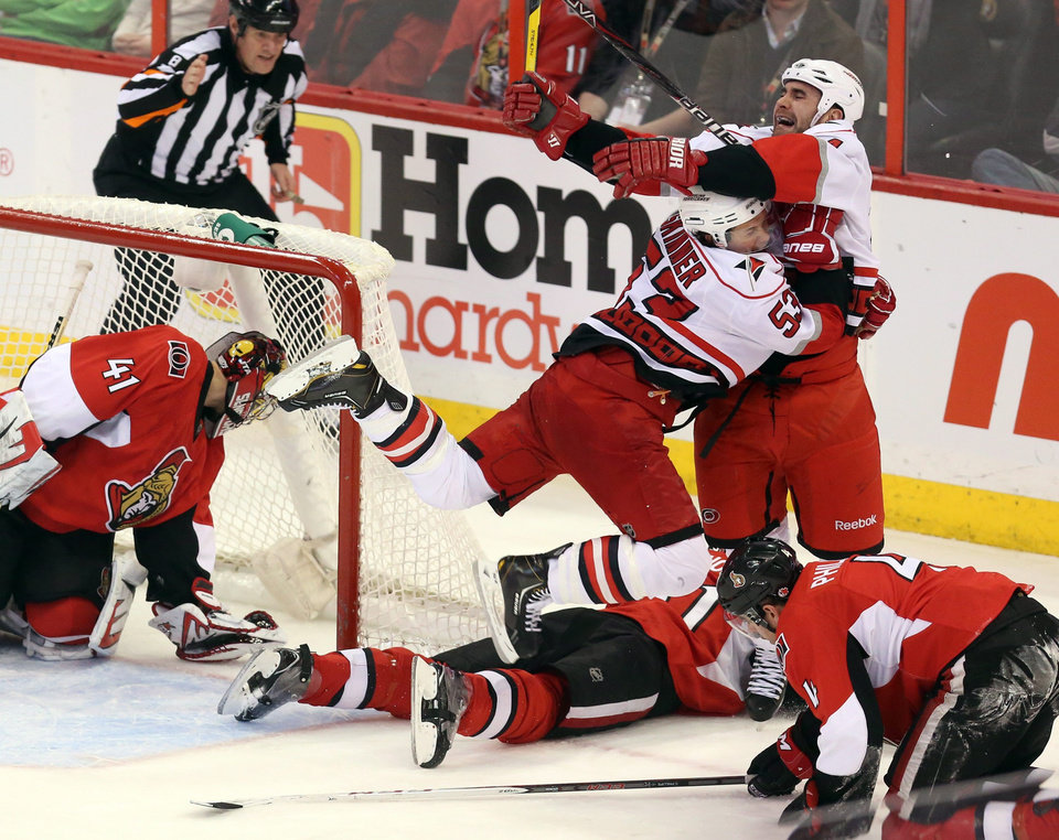 Carolina Hurricanes' Jay Harrison (44) celebrates his winning goal in overtime with teammate Jeff Skinner (55) to defeat the Ottawa Senators in an NHL hockey game in Ottawa, Ontario, Thursday, Feb. 7, 2013. (AP Photo/The Canadian Press, Fred Chartrand)