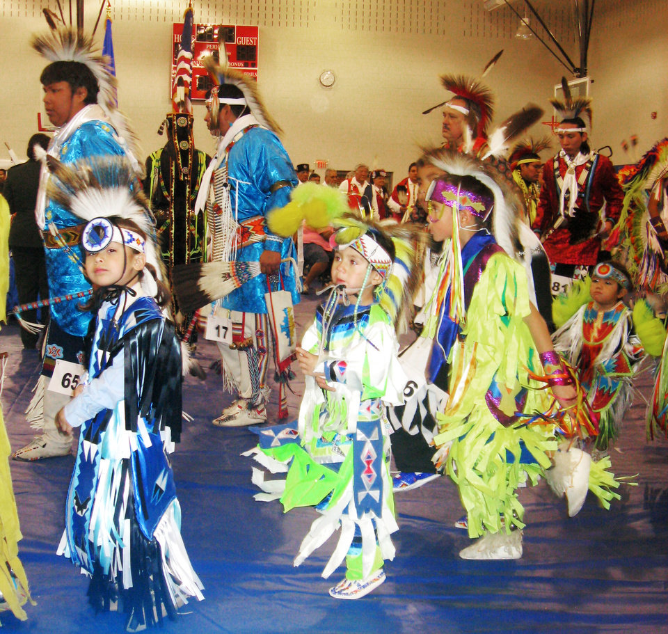 Photo - POWWOW: Three young students dancing at last year's pow-wow. The Oklahoma City Public Schools Native American Students pow-wow Nov. 21 at John Marshall HS. ORG XMIT: KOD