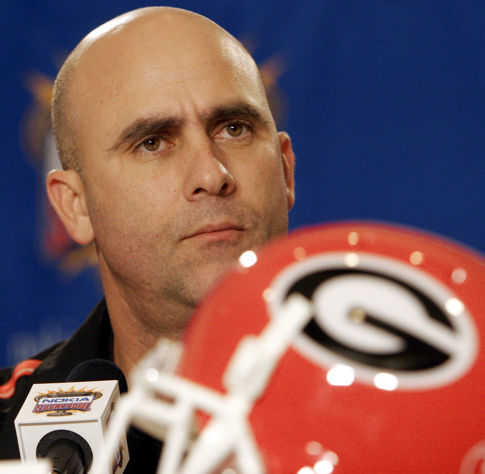 Photo - ASSISTANT FOOTBALL COACH: Georgia's defensive coordinator Willie Martinez listens to a question at a news conference at the Sugar Bowl in Atlanta, Friday, Dec. 30, 2005. Georgia play West Virginia in the Sugar Bowl on Jan. 2. The game was moved from New Orleans due to Hurricane Katrina. (AP Photo/Bill Haber) ORG XMIT: GAWH105 ORG XMIT: 1002041407299664