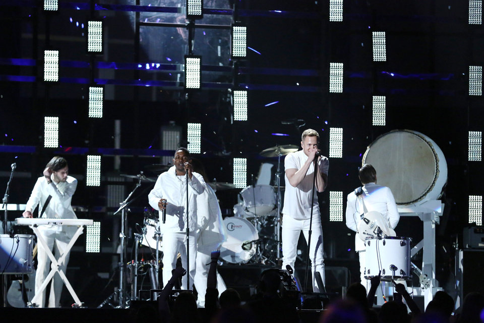Photo - Kendrick Lamar, center left, and Dan Reynolds, center right, perform at the 56th annual Grammy Awards at Staples Center on Sunday, Jan. 26, 2014, in Los Angeles. (Photo by Matt Sayles/Invision/AP)