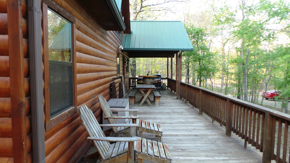 Photo - Porches surround the Bella Lodge Cabin in southeast Oklahoma, inviting visitors to sit and enjoy the sounds of wildlife -- and the silence. PHOTO BY LILLIE-BETH BRINKMAN