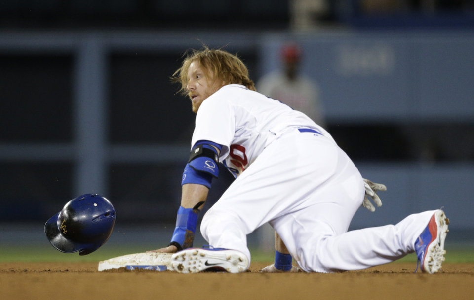 Photo - Los Angeles Dodgers' Justin Turner steals the second base during the seventh inning of a baseball game against the Philadelphia Phillies on Tuesday, April 22, 2014, in Los Angeles. (AP Photo/Jae C. Hong)