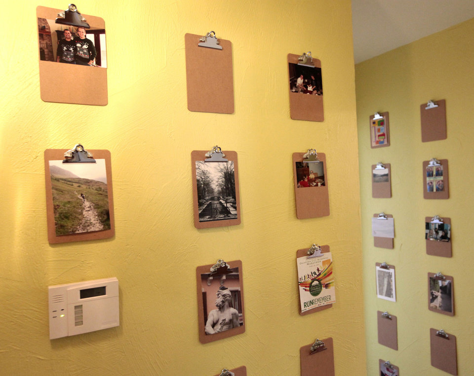 Photo - Brent Forget has hung 102 small clipboards, which serve as mounts for photos, clippings and mementos, in a hall at his home 2732 NW 15.  David McDaniel - The Oklahoman