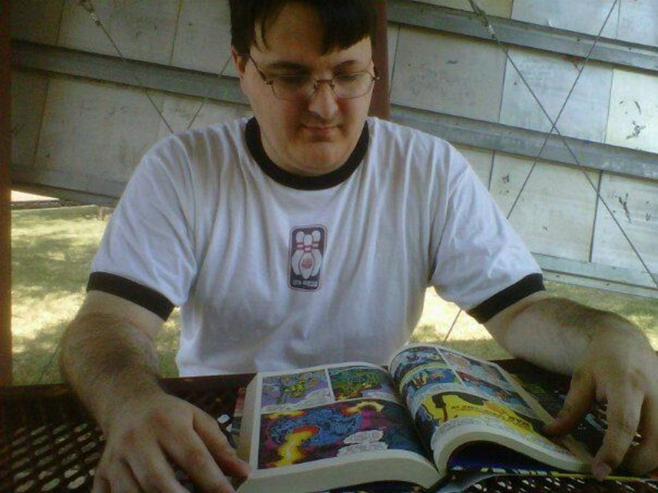 Blogger Matt Price reads Jack Kirby comics in public on a previous Read Comics in Public Day.