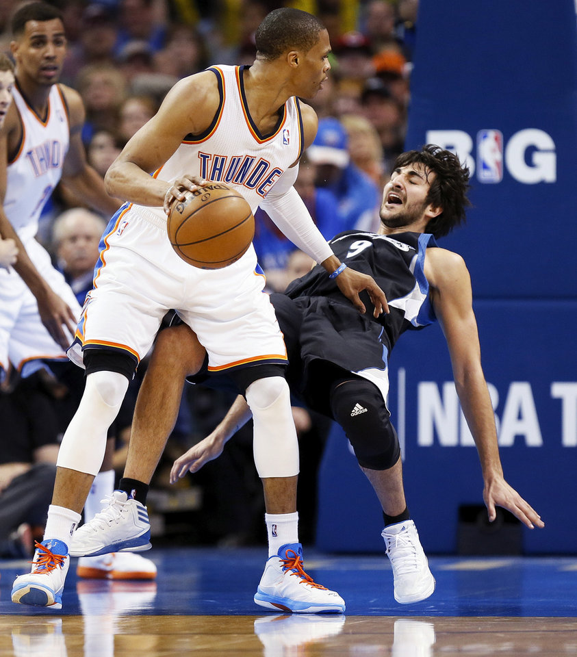 Minnesota's Ricky Rubio (9) falls to the court while defending Oklahoma City's Russell Westbrook (0) during an NBA basketball game between the Oklahoma City Thunder and Minnesota Timberwolves at Chesapeake Energy Arena in Oklahoma City, Friday, Feb. 22, 2013. There was no foul on the play. Oklahoma City won, 127-111. Photo by Nate Billings, The Oklahoman