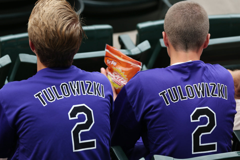 Photo - Fans wear shirts emblazoned with the misspelled surname of Colorado Rockies All-Star shortstop Troy Tulowitzki that were given away to attendees as the Rockies hosted the Pittsburgh Pirates in a baseball game in Denver, Saturday, July 26, 2014. (AP Photo/David Zalubowski)