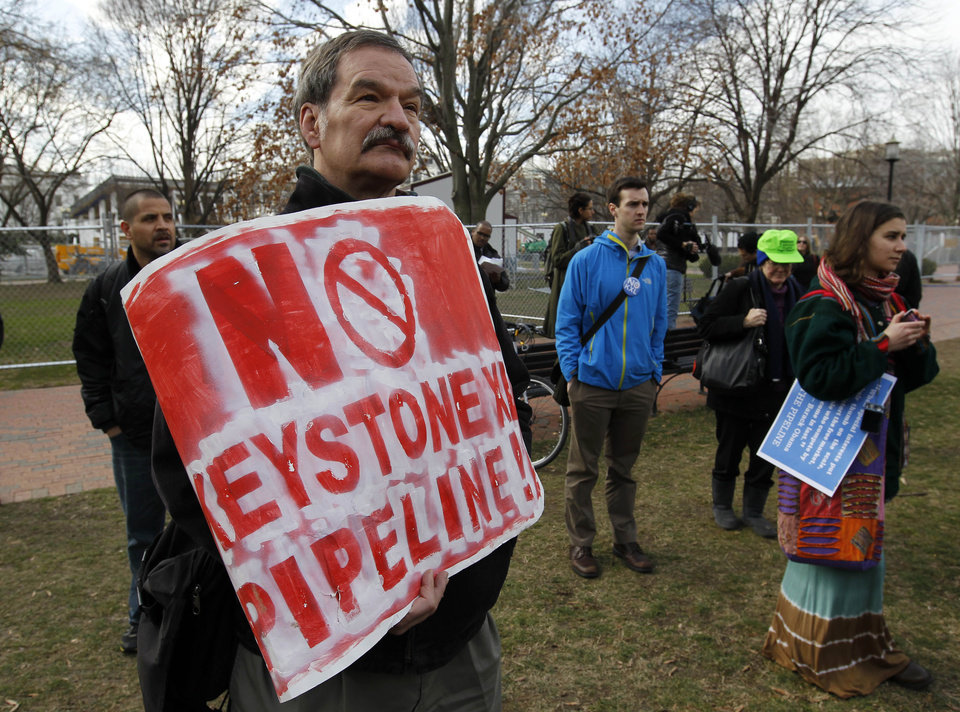 Protestors gather in Lafayette Park, across the street from the White House in Washington, Wednesday, Feb. 13, 2013, before prominent environmental leaders tied themselves to the White House gate to protest the Keystone XL oil pipeline. (AP Photo/Ann Heisenfelt)