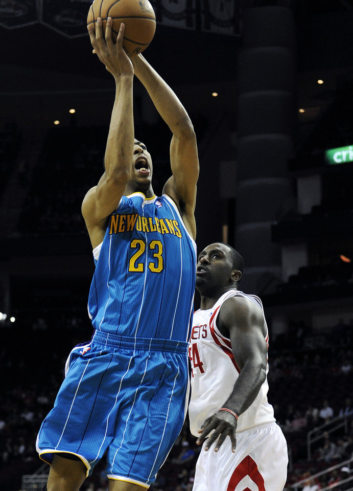 New Orleans Hornets' Anthony Davis (23) shoots as Houston Rockets' Patrick Patterson (54) looks on during the first half of an NBA basketball game, Wednesday, Nov. 14, 2012, in Houston. (AP Photo/Pat Sullivan)