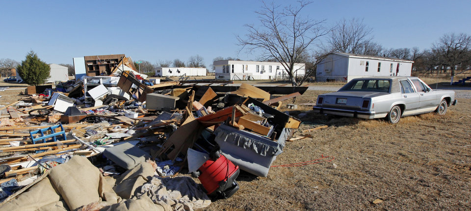 Photo - A view of a destroyed mobile home while other mobile homes across the road are still standing at the Bar K Mobile Home Park in Lone Grove, Okla., Wednesday, February 11, 2009. On Tuesday, February 10, 2009, a tornado moved through Lone Grove killing at least eight people. BY NATE BILLINGS, THE OKLAHOMAN