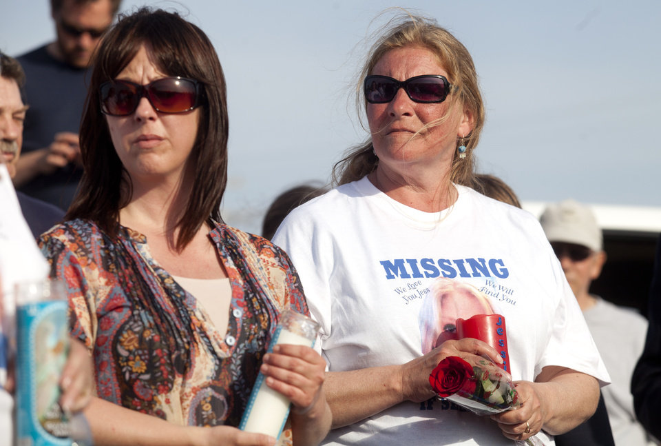 Shelly Heeringa, mother of 25-year-old Jessica Heeringa stands during a vigil for her daughter on Tuesday, April 30, 2013 at Pointes Mall in Norton Shores, Mich. Jessica Heeringa was allegedly abducted at about 11 p.m. on Friday, April 26, 2013 from the Exxon Mobil gas station at 1196 E. Sternberg Road, where she worked as a night clerk. Hundreds gathered at the mall, close to where Heeringa worked, to light candles, show support to her family, and pray for her well being. (AP Photo/The Muskegon Chronicle, Jon Garcia) ALL LOCAL TV OUT; LOCAL TV INTERNET OUT