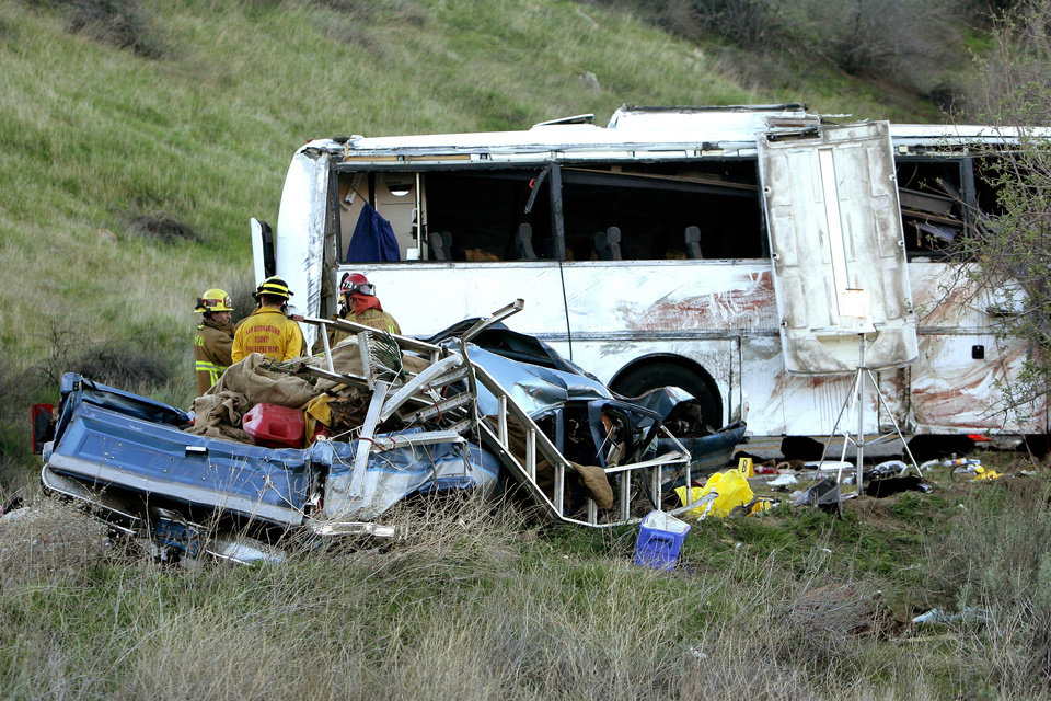 Investigators continue to work the scene of a bus crash that happened overnight on Highway 38 that killed at least 8 people on Monday, Feb. 4, 2013. California Highway Patrol spokesman Mario Lopez said Monday morning that the number of eight confirmed deaths was expected to rise because the coroner was just starting to remove bodies from the mangled vehicles and also take away the remains of those who were ejected. (AP Photo/The Press-Enterprise, Stan Lim)  NO SALES; MAGS OUT; MANDATORY CREDIT
