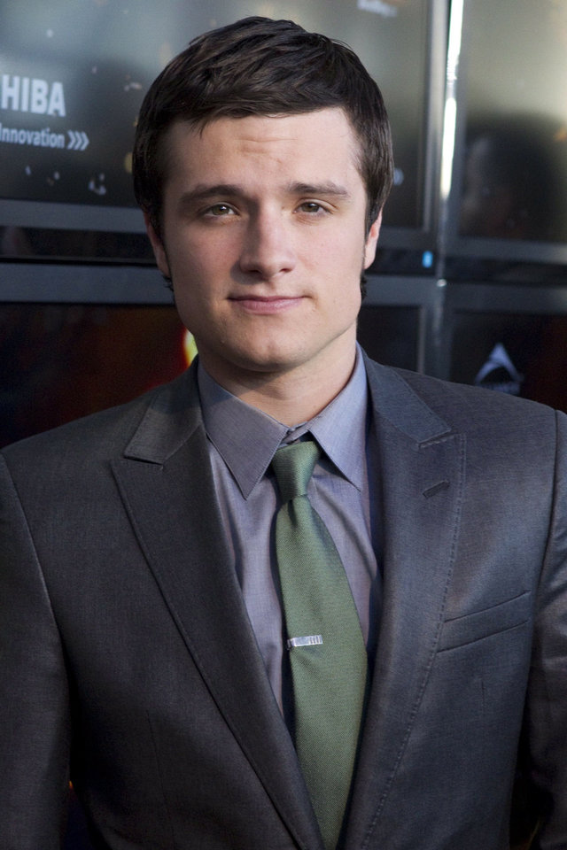 Photo - Josh Hutcherson, who portrays Peeta Mellark, poses on the red carpet for the premier the film