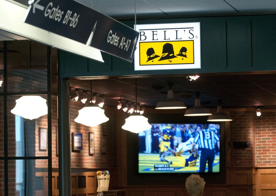 Photo - This Sept. 11, 2013, photo shows the Bell's beer pub that is scheduled to open soon inside the Gerald R. Ford Airport in Grand Rapids, Mich. Bell's beers on tap will be Midwestern Pale Ale, Kalamazoo Stout, Best Brown Ale, Two Hearted Ale, Amber Ale and Third Coast Pale Ale. Other domestic beers, liquor and wine also will be served. (AP Photo/MLive.com, Chris Clark)