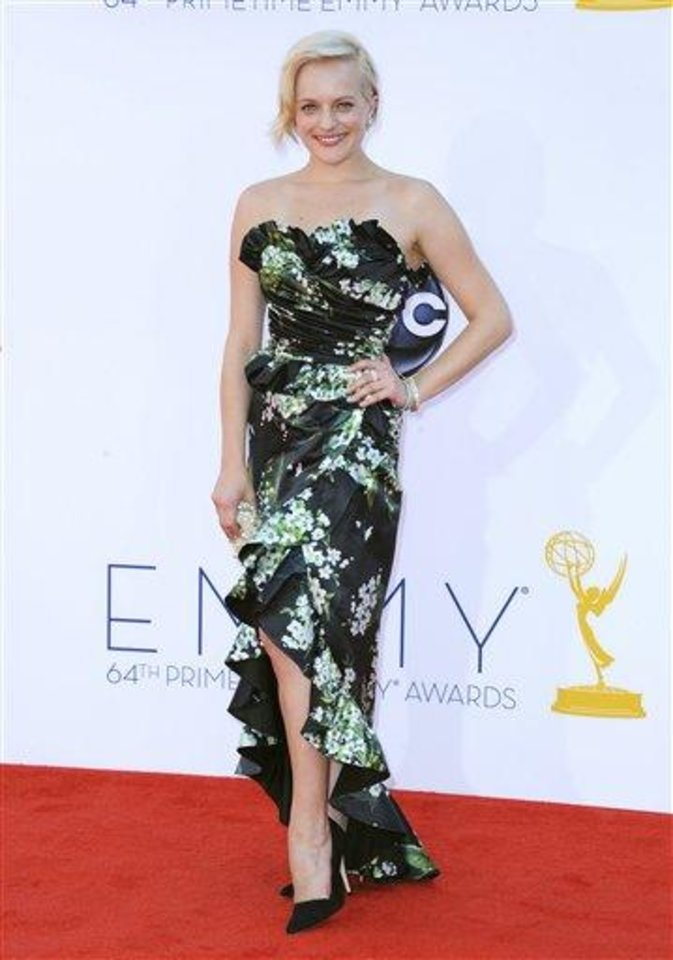 Actress Elisabeth Moss arrives at the 64th Primetime Emmy Awards at the Nokia Theatre on Sunday, Sept. 23, 2012, in Los Angeles.  (Photo by Jordan Strauss/Invision/AP)