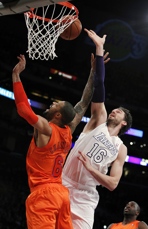 New York Knicks center Tyson Chandler (6) battles Los Angeles Lakers forward Pau Gasol (16), of Spain, for a rebound during the first half of their NBA basketball game in Los Angeles, Tuesday, Dec. 25, 2012. (AP Photo/Alex Gallardo)