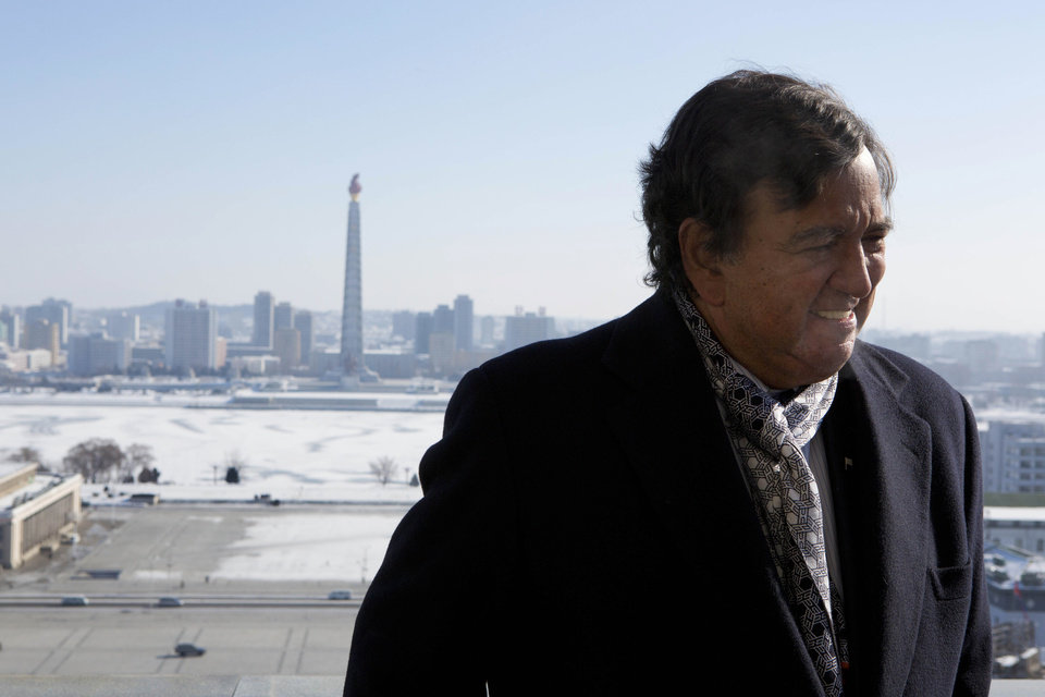 Photo - Former New Mexico Bill Richardson stands on a balcony at the Grand Peoples Study House overlooking Juche Tower in Pyongyang, North Korea on Wednesday, Jan. 9, 2013. Richardson said Wednesday that his delegation is pressing North Korea to put a moratorium on missile launches and nuclear tests and to allow more cell phones and an open Internet for its citizens. (AP Photo/David Guttenfelder)