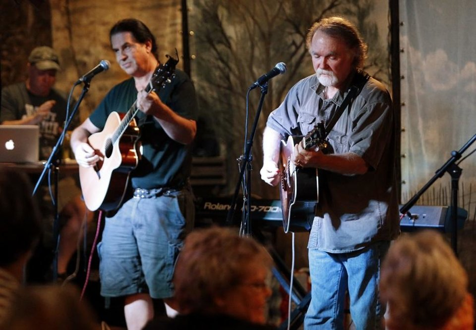Photo - Greg Jacobs, right, and Gene Williams play on the Brickstreet Stage during the 2013 Woody Guthrie Folk Festival on Thursday, July 11, 2013 in Okemah, Okla. [The Oklahoman Archives photo]