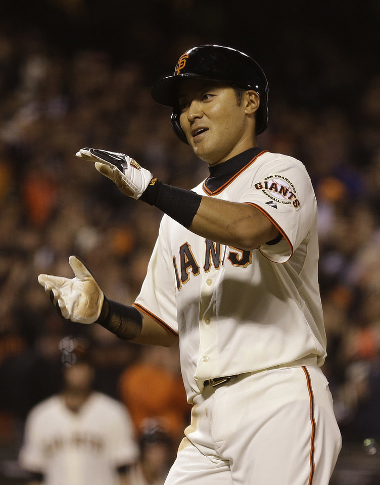 Photo - San Francisco Giants' Kensuke Tanaka crosses home plate to score the Giants' fifth run in the seventh inning of their baseball game against the New York Mets Tuesday, July 9, 2013, in San Francisco. Tanaka, of Japan, was playing his first Major League Baseball game. (AP Photo/Eric Risberg)