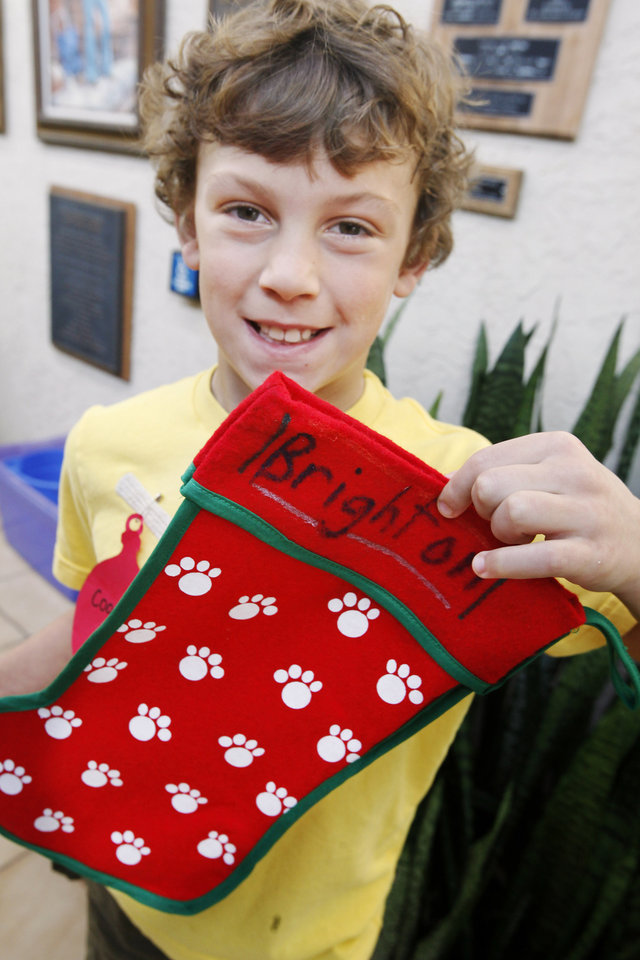 "CHILD / CHILDREN / KIDS: Cooper Shepherd,  8 from Okla. City, with a stocking he made for his dog Brighton during a class titled ""Pet Presents' at the Oklahoma City Zoo Wednesday, Dec. 21, 2011. Photo by Paul B. Southerland, The Oklahoman ORG XMIT: KOD"