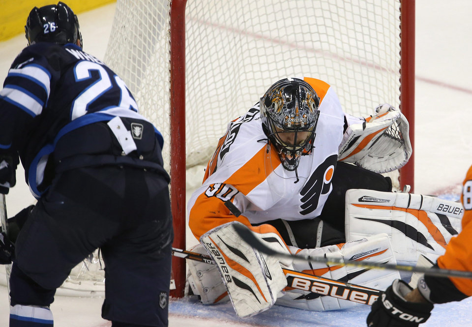 Winnipeg Jets' Blake Wheeler (26) is stopped by Philadelphia Flyers' goaltender Ilya Bryzgalov during the third period of an NHL hockey game in Winnipeg, Manitoba, Tuesday, Feb. 12, 2013. (AP Photo/The Canadian Press, Trevor Hagan)