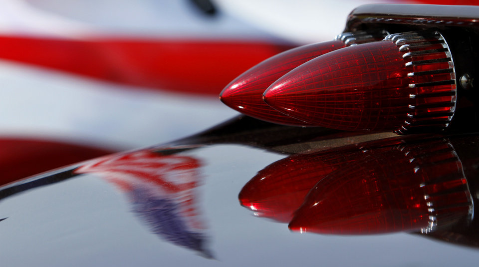 An American flag is reflected in the paint of a 1930 Ford roadster on display during Celebration In The Heartland at Buck Thomas Park in Moore, Wednesday July 4, 2013. Photo By Steve Gooch, The Oklahoman