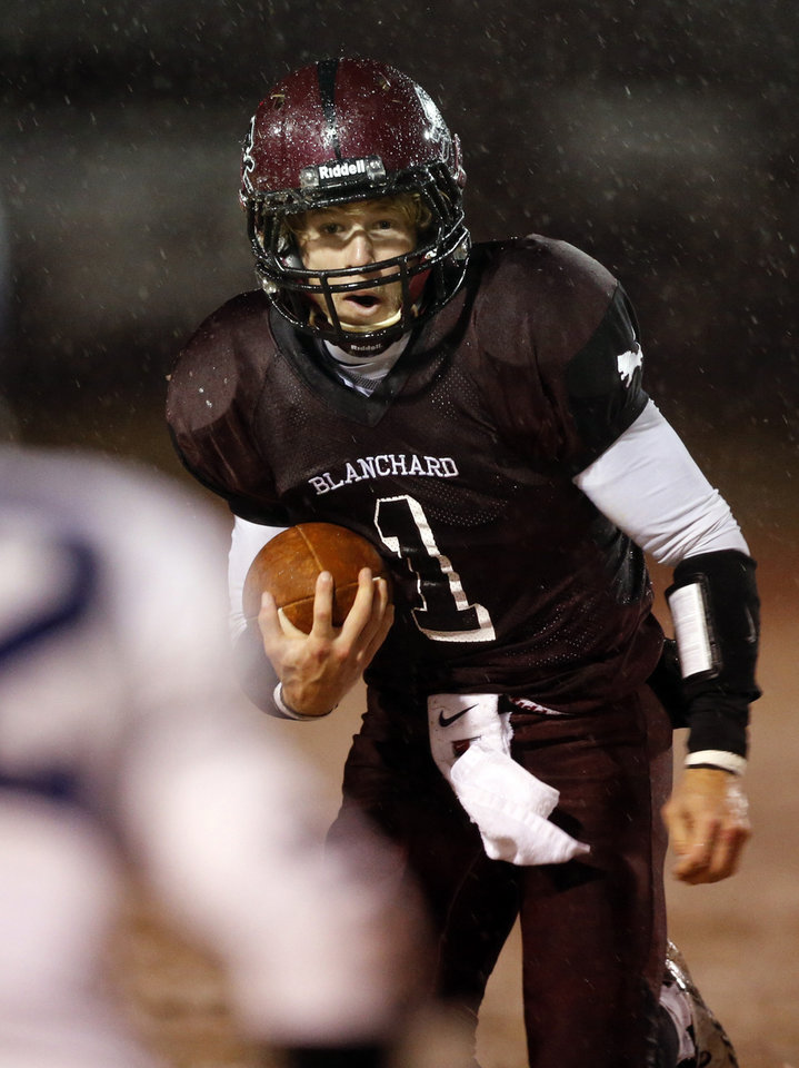 Photo - Blanchard quarterback Blake Owen looks for running room as Newcastle plays Blanchard in Class 3A high school football playoffs on Friday, Nov. 22, 2013, in Blanchard, Okla. Photo by Steve Sisney, The Oklahoman