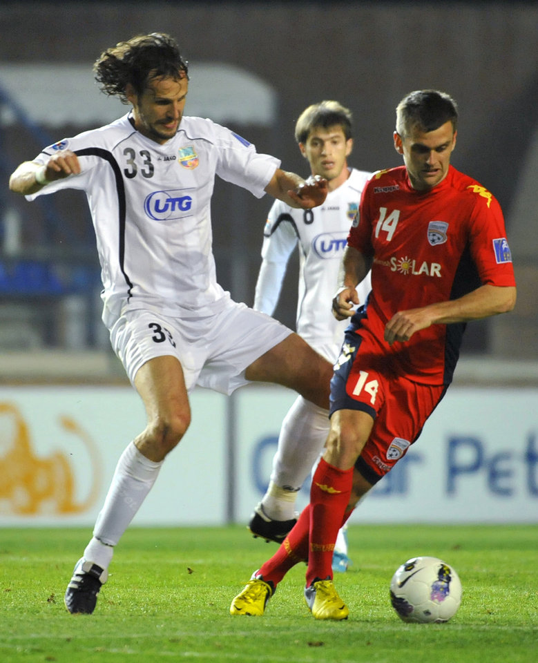 Adelaide United's Cameron Watson, right, and Bunyodkor's Jan Kozak vie for the ball during their 2012 AFC Champions League quarter-final second leg match in Tashkent, Uzbekistan, Wednesday, Oct. 3, 2012. (AP Photo/Anvar Ilyasov)