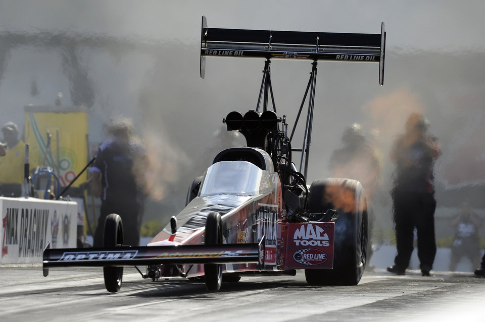 Photo - In this photo provided by the NHRA, J.R. Todd qualifies No. 1  in Top Fuel at the Pep Boys NHRA Carolina Nationals drag races at zMAX Dragway on Saturday, Sept. 13, 2014, in Concord, N.C. Todd will face Clay Millican in the first round of eliminations. (AP Photo/NHRA, Marc Gewertz)