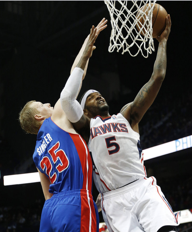 Atlanta Hawks small forward Josh Smith (5) goes up for a basket as Detroit Pistons small forward Kyle Singler (25) defends in the first half of an NBA basketball game on Wednesday, Dec. 26, 2012, in Atlanta. (AP Photo/John Bazemore)