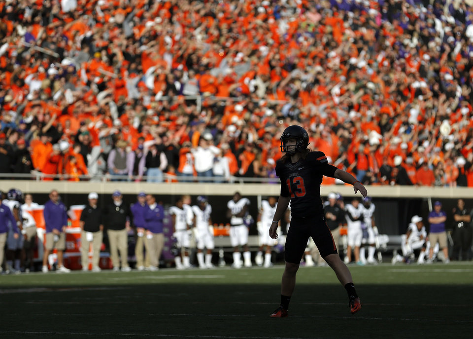 Photo - Oklahoma State's Quinn Sharp (13) lines up for a kick during a college football game between Oklahoma State University (OSU) and Texas Christian University (TCU) at Boone Pickens Stadium in Stillwater, Okla., Saturday, Oct. 27, 2012. Photo by Sarah Phipps, The Oklahoman
