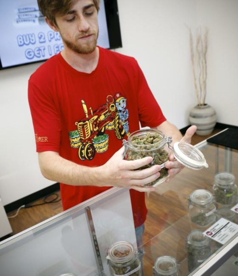 Photo -  Jacob Gorman, co-owner of Top Shelf medical cannabis dispensary, talks about some of the products at Top Shelf, 2518 N Meridian Ave. [Nate Billings/The Oklahoman]