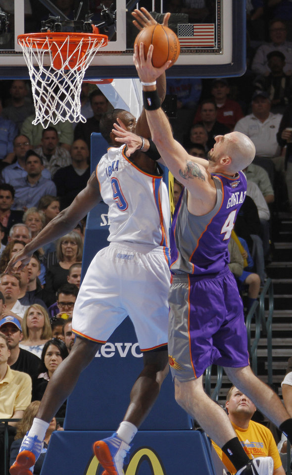Oklahoma City Thunder power forward Serge Ibaka (9) blocks a shot by Phoenix Suns center Marcin Gortat (4) during the NBA basketball game between the Oklahoma City Thunder and the Phoenix Suns at the Chesapeake Energy Arena on Wednesday, March 7, 2012 in Oklahoma City, Okla.  Photo by Chris Landsberger, The Oklahoman