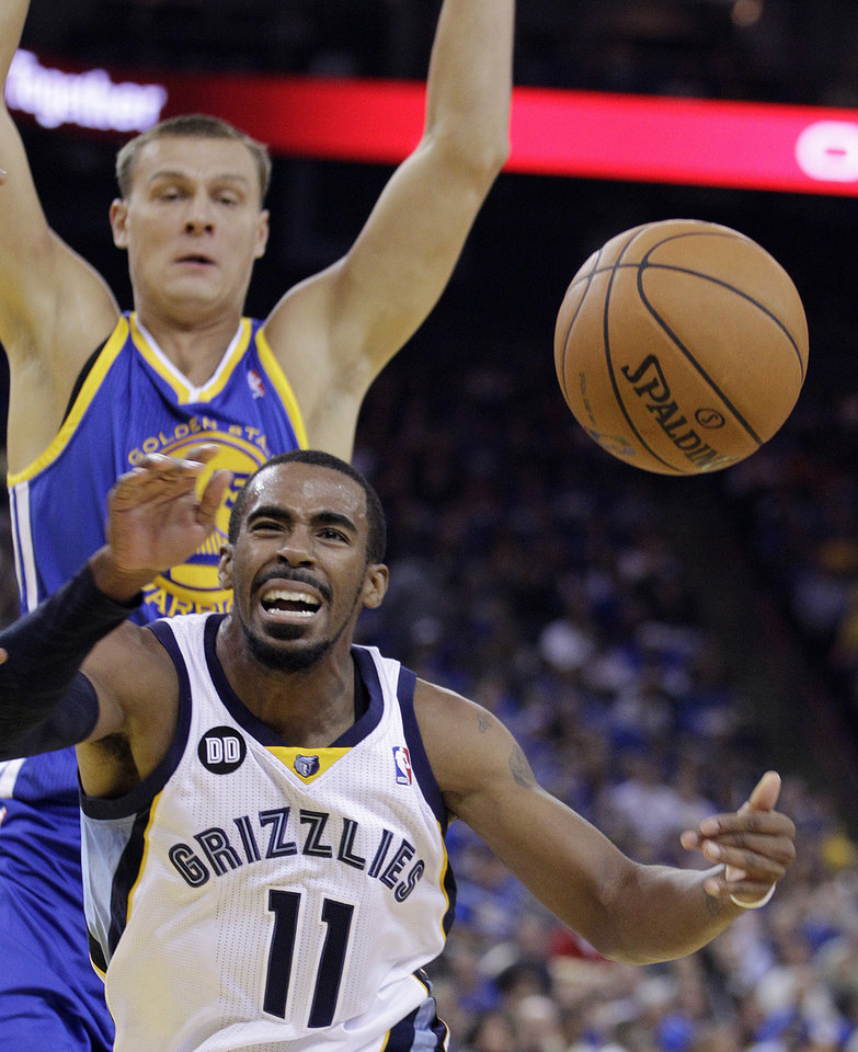 Memphis Grizzlies' Mike Conley (11) loses the ball while driving against Golden State Warriors' Andris Biedrins during the first half of an NBA basketball game Friday, Nov. 2, 2012, in Oakland, Calif. (AP Photo/Ben Margot)