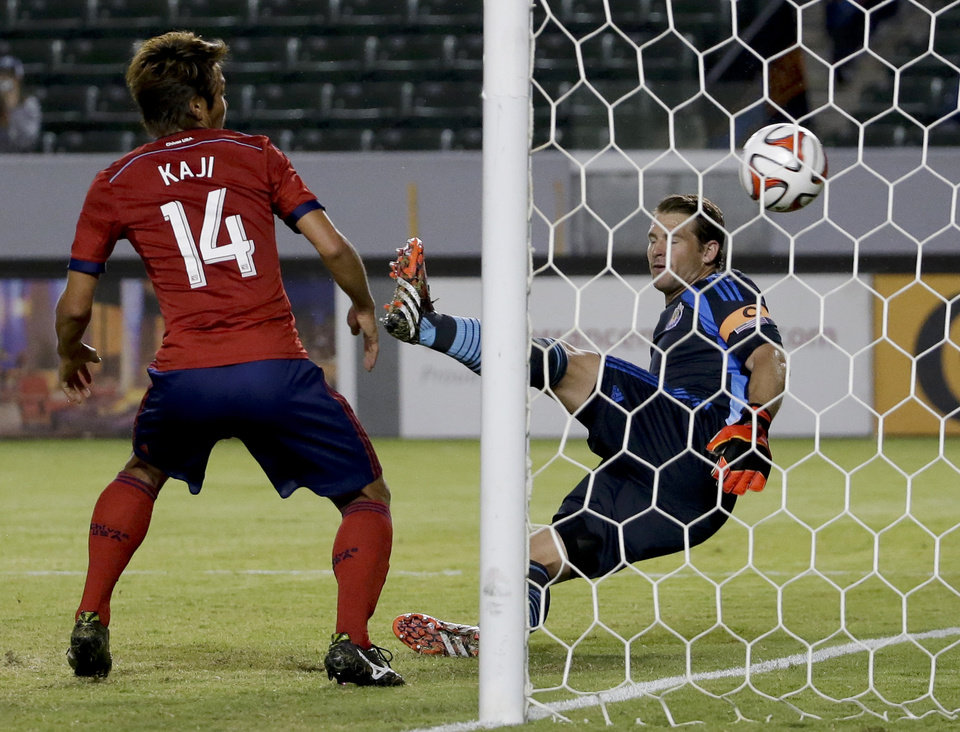 Photo - Chivas USA's Akira Kaji, left, and goalkeeper Dan Kennedy watch a goal by Seattle Sounders forward Obafemi Martins during the first period of an MLS soccer match Wednesday, Sept. 3, 2014, in Carson, Calif. (AP Photo/Chris Carlson)