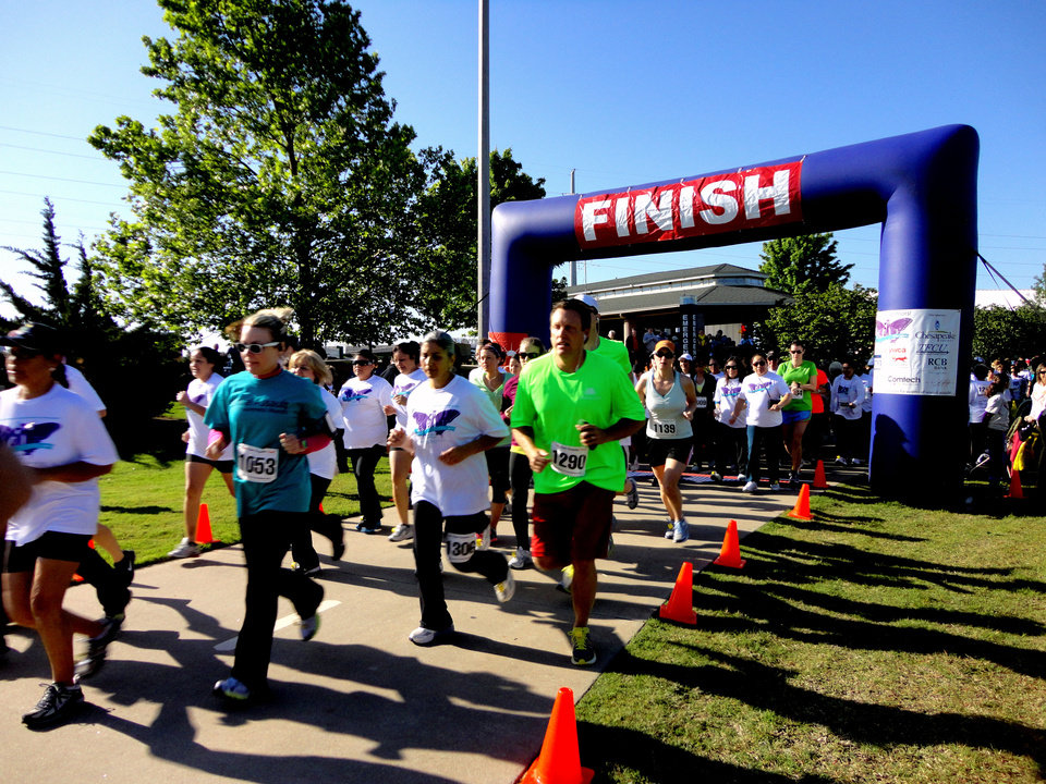 Photo - Runners finish the recent YWCA Oklahoma City 2-Minute 5K. PHOTO BY TIFFANY M. POOLE, FOR THE OKLAHOMAN.