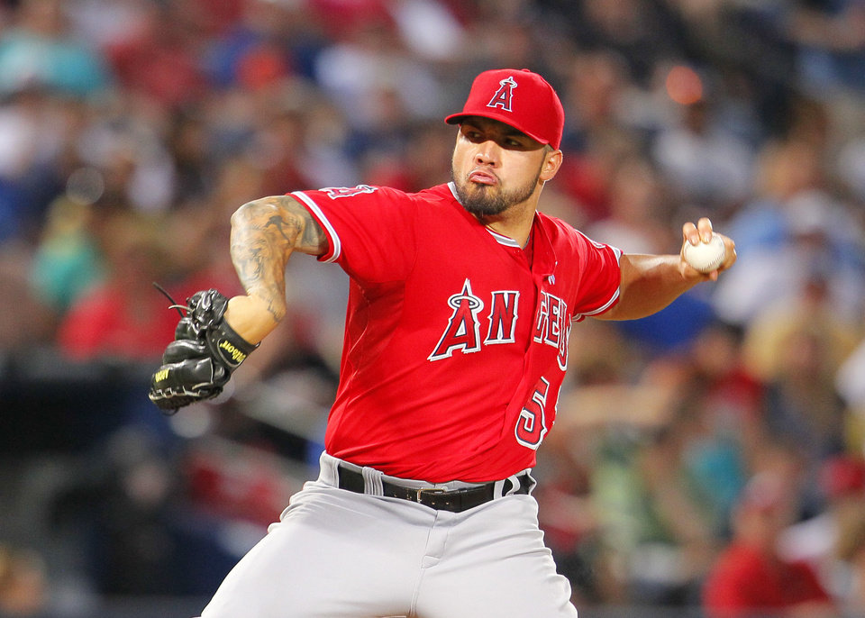 Photo - Los Angeles Angels starting pitcher Hector Santiago delivers in the second inning inning of an interleague baseball game against the Atlanta Braves Sunday, June 15, 2014, in Atlanta. (AP Photo/Todd Kirkland)