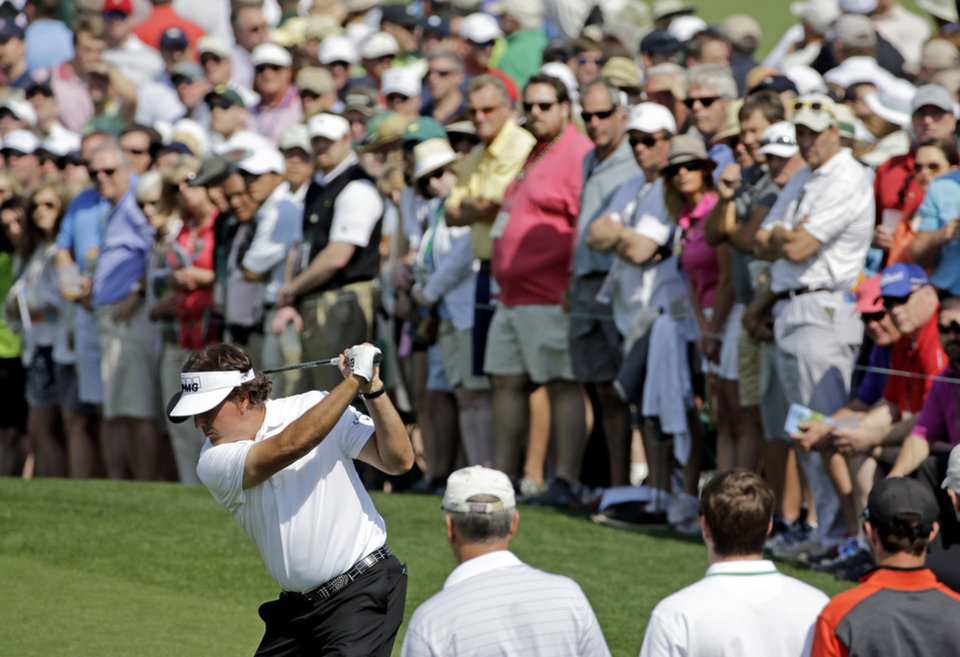 Photo - Phil Mickelson tees off on the second hole during the second round of the Masters golf tournament Friday, April 11, 2014, in Augusta, Ga. (AP Photo/David J. Phillip)