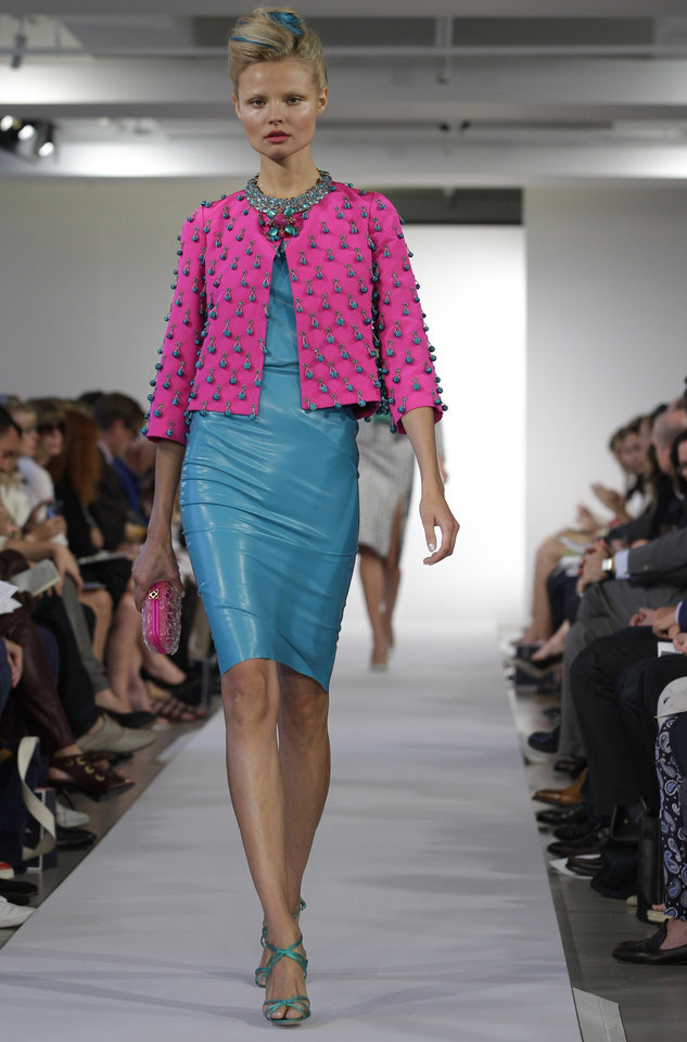 Photo -   A model walks the runway during the presentation of the Oscar de la Renta Spring 2013 collection at Fashion Week in New York, Tuesday, Sept. 11, 2012. (AP Photo/Kathy Willens)
