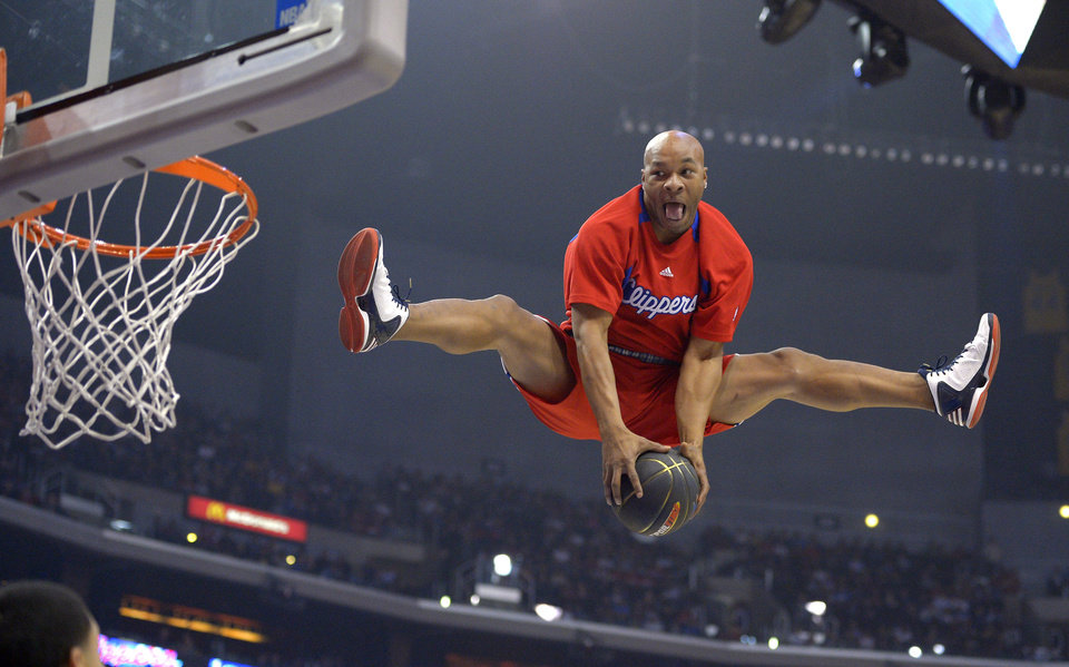 Antoine Lewis of the Los Angeles Clippers Dunk Squad goes up for a dunk during a timeout in the Los Angeles Clippers NBA basketball game against the Oklahoma City Thunder, Tuesday, Jan. 22, 2013, in Los Angeles. (AP Photo/Mark J. Terrill) ORG XMIT: LAS110