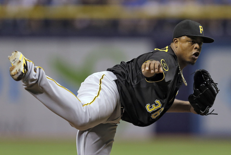 Photo - Pittsburgh Pirates starting pitcher Edinson Volquez follows through on a pitch to the Tampa Bay Rays during the first inning of an interleague baseball game, Monday, June 23, 2014, in St. Petersburg, Fla. (AP Photo/Chris O'Meara)